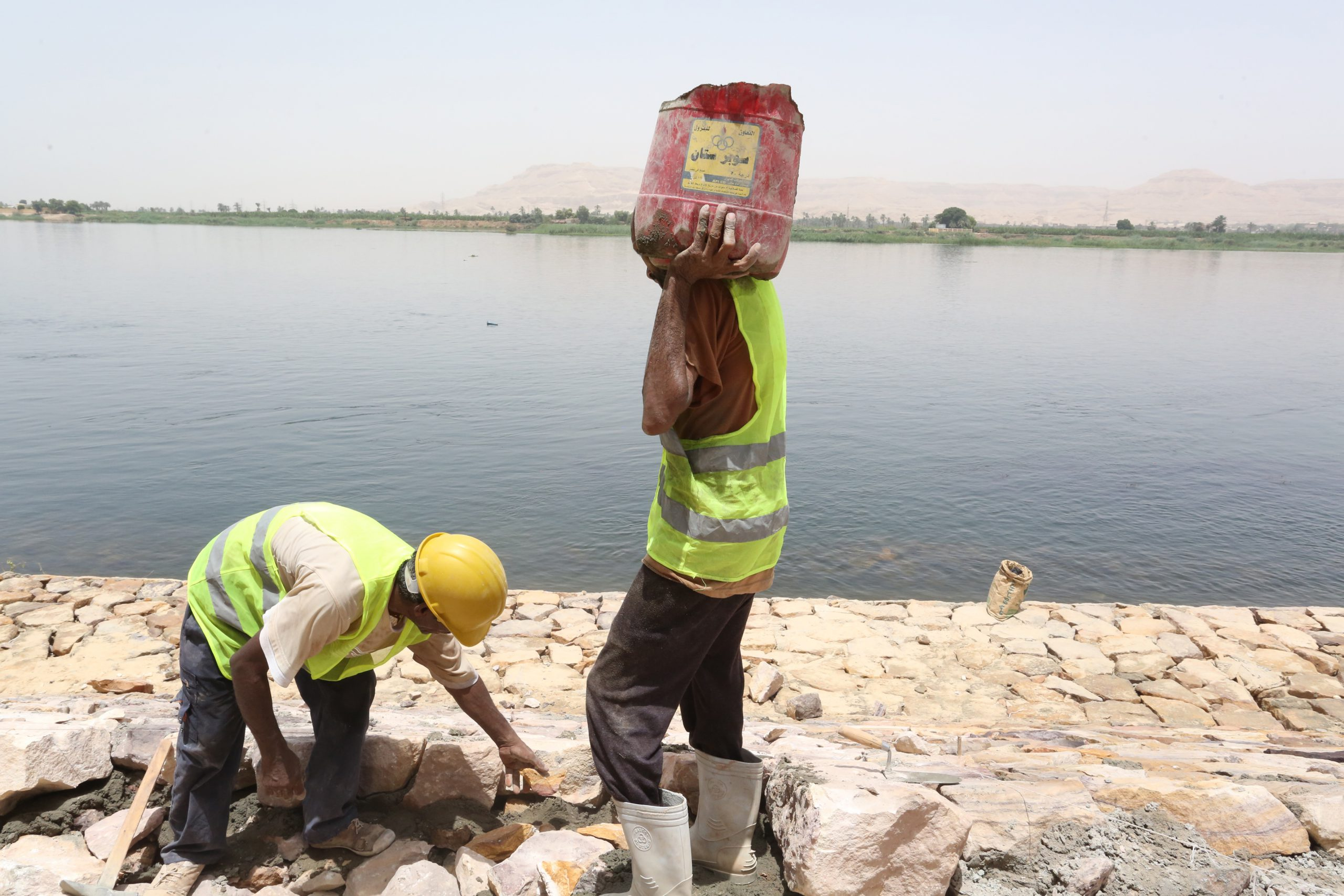 Construction workers are building stronger river banks along the Nile river to protect it from erosion, Egypt